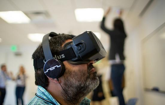 Photo of man with virtual reality headset on