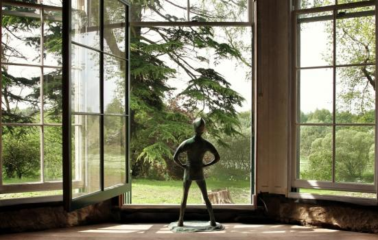 Photo of a Peter Pan statue in a window