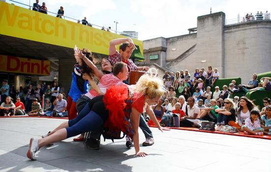 Stopgap Dance Company performing outside at the Watch This Space Festival, National Theatre