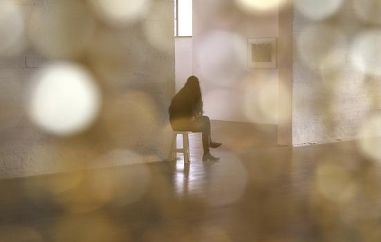 Photo of someone sitting in a gallery
