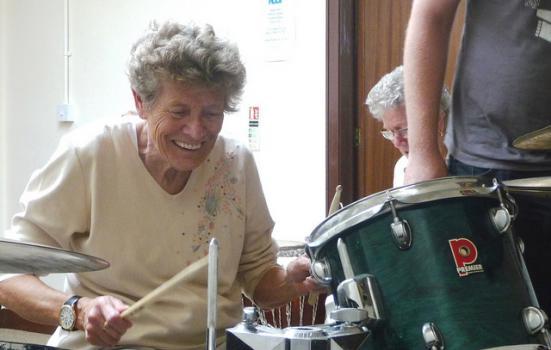 Woman drumming