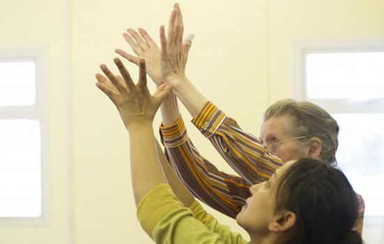 Photo of rehearsing hand movements at a dementia workshop