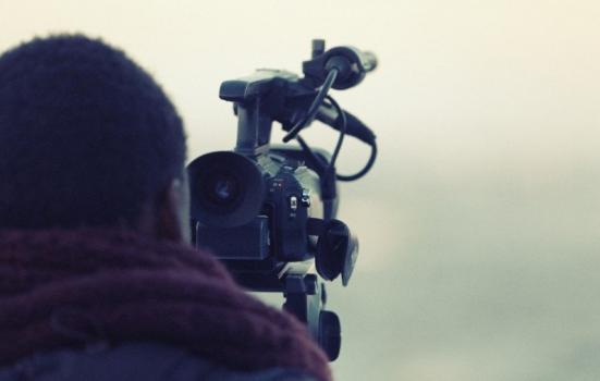 A photo of a man behind a camera