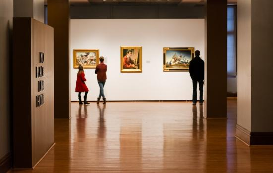 A photo of people in an art gallery