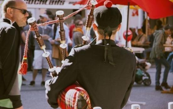Photo of bagpipe player