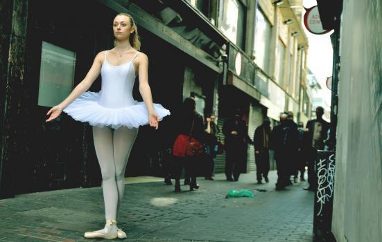 Photo of ballet dancer in grimy street
