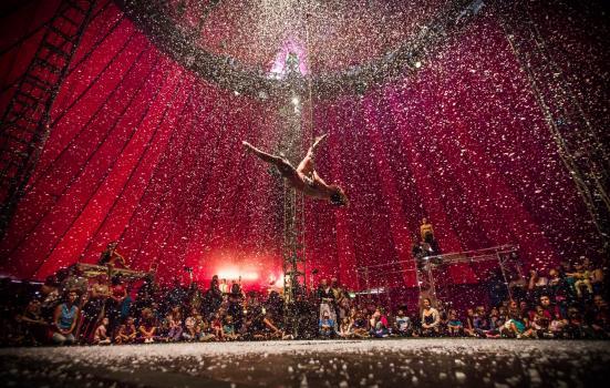 Photo of acrobat in circus tent