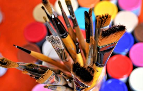 Photo of a brush and paint pots