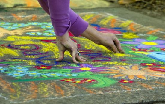 Photo of person doing chalk drawing