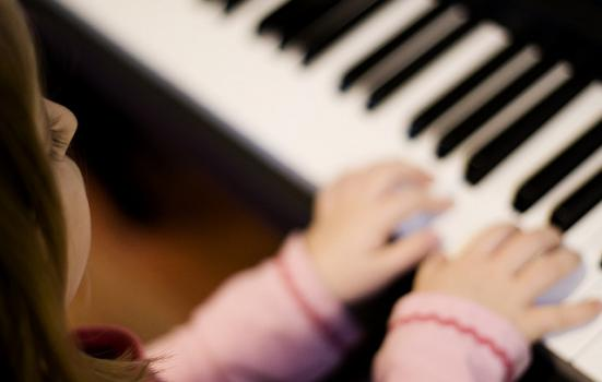 Photo of girl playing piano