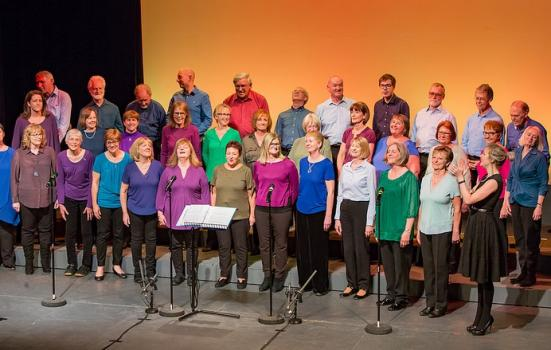 A choir of people wearing colourful clothes
