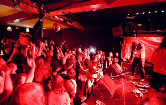 Crowd surfing at a packed gig