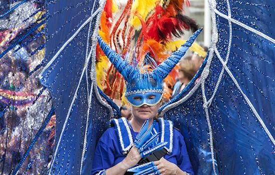 Photo of someone in bright blue carnival dress