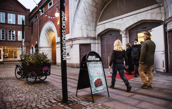 Photo of entrance to theatre with pedestrians
