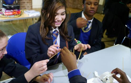 Photo of teenagers taking place in design workshop