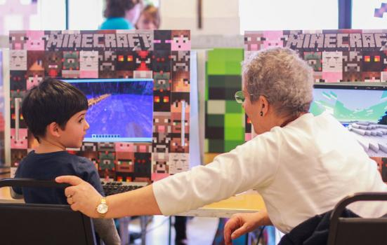 Photo of woman and child playing Minecraft