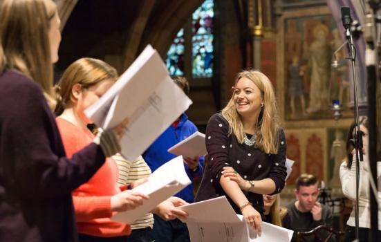 Photo of ORA Singers in rehearsal for one of their new commissions