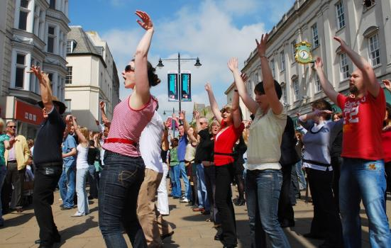 Photo of people dancing in the street