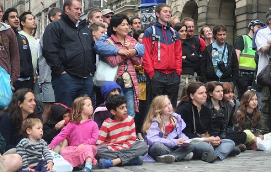 Crowd watching street theatre