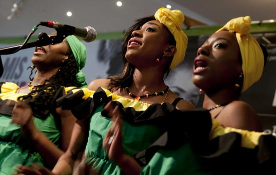 Photo of three women singing