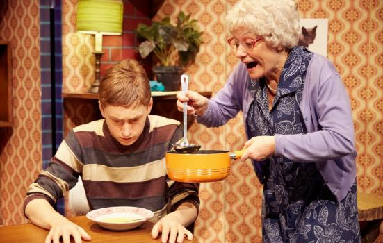 Production shot: granny feeding grandson