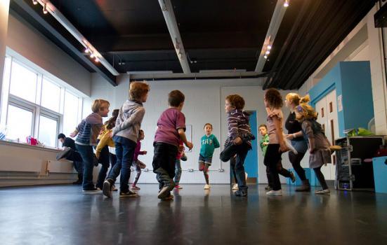 Children in a theatre workshop