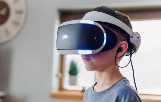 young girl wearing a virtual reality headset