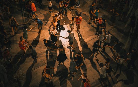 A photo of people dancing on a dancefloor