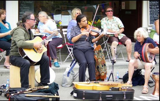 Photo of musicians playing on the street