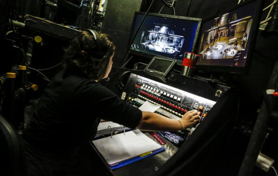 Someone operating a lighting board at the mercury theatre