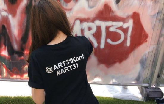 Photo of girl painting graffiti