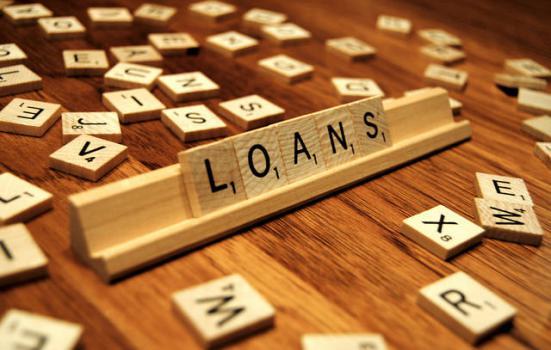 Photo of 'loans' spelt out in scrabble tiles