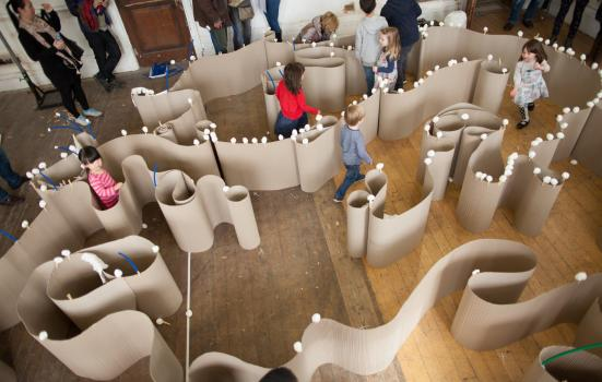 Photo of children walking round a maze made of paper