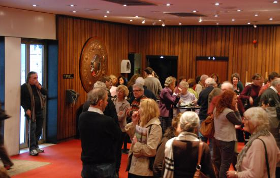 Photo of people in theatre lobby