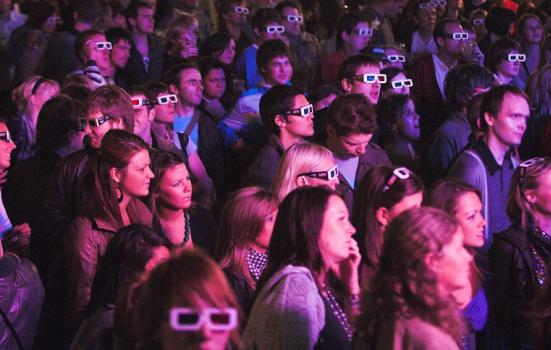Photo of audience with 3D glasses on