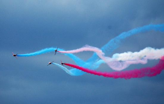 Photo of aeroplanes trailing coloured smoke
