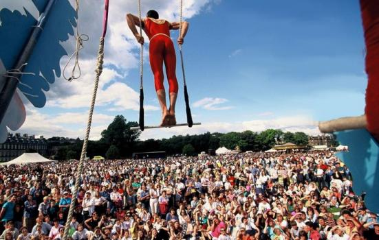 Image of trapeze artist at outdoor festival