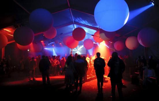 Photo of balloons in dark room