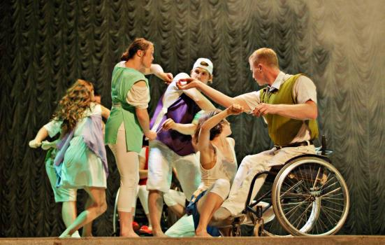 Photo of dancers, one in wheelchair