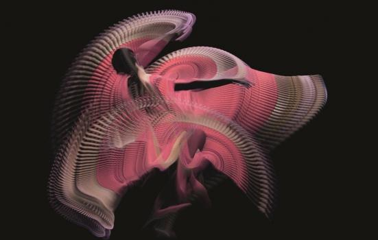 Photo of dancer in swirly pink dress