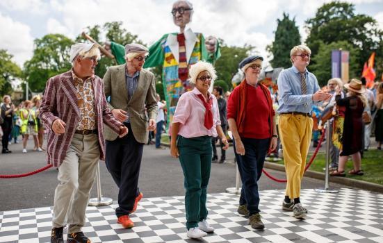 Group of people dressed like David Hockney