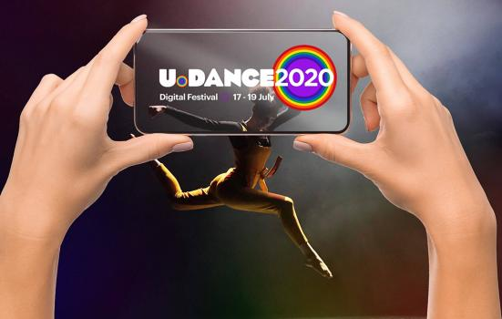 image of a pair of hands taking a photo on a mobile phone of a dancer in mid air - the phone has the U.Dance 2020 logo in the foreground