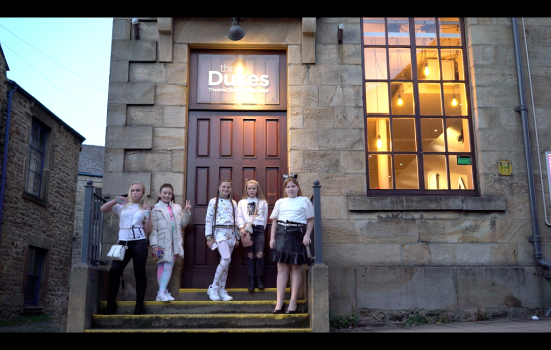 Five young Traveller girls outside the front door of the dukes lancaster