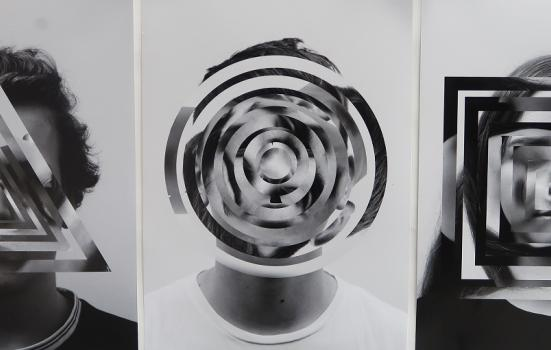 A black and white artwork with people's faces covered in patterns