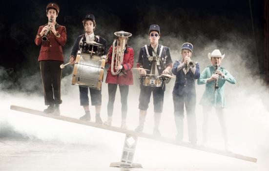 Photo of musicians on see-saw