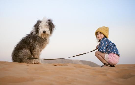 Photo of a girl and a dog