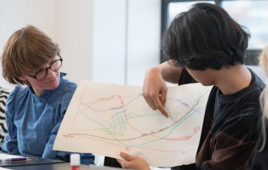 Photo of two women looking at a diagram