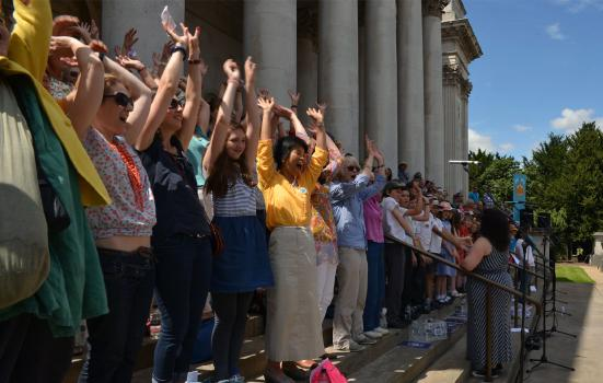 A choir performing out the front of the Fitzwilliam Museum