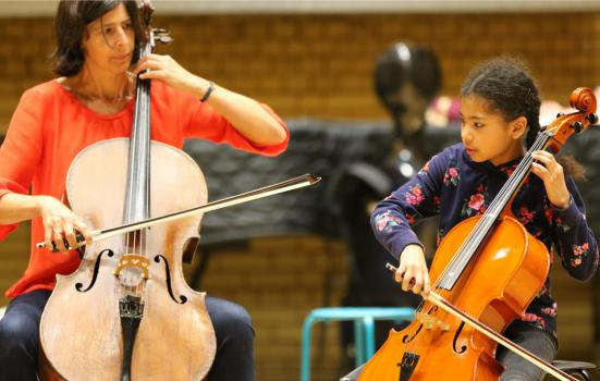 Photo of a tutor and pupil playing the cello