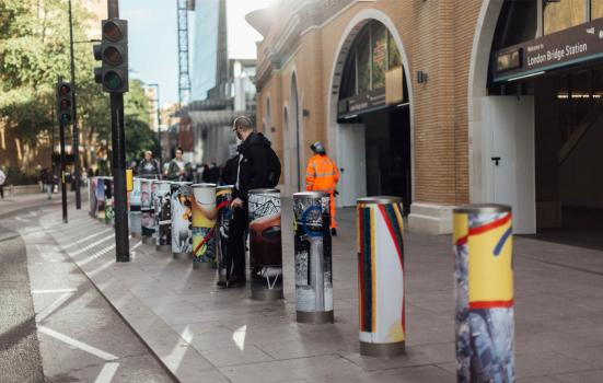Photo of public art project outside London Bridge Station - painted bollards